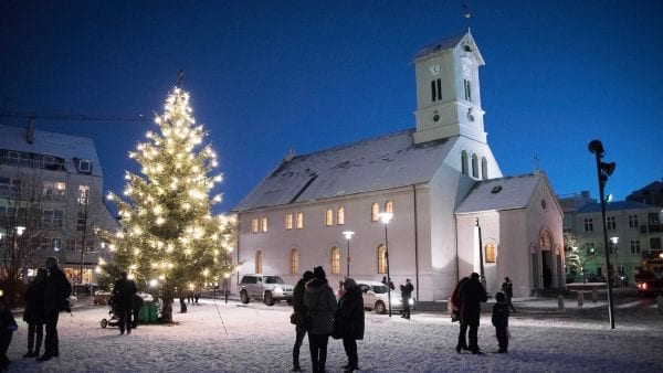 Church and decorated tree in Iceland