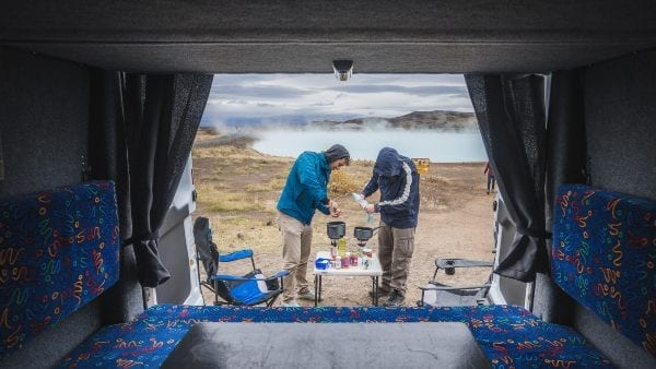 looking out the back of a camper in winter in iceland