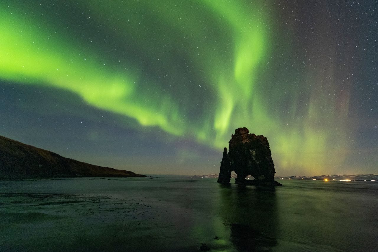 cliff and northern lights