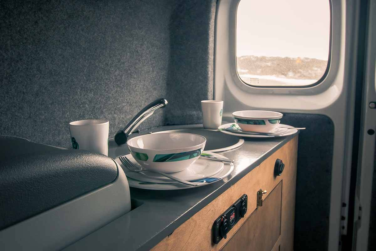 dishes on a table in a camper