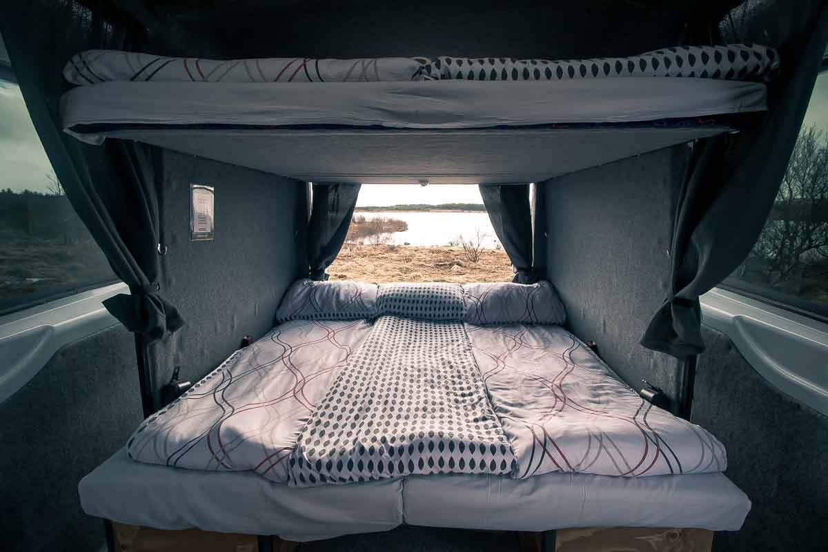 camper with bedding laid out