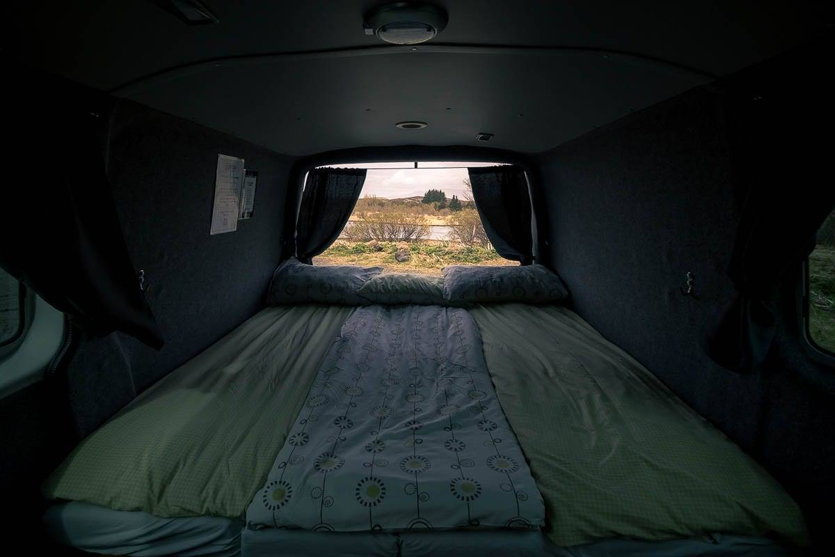 bedding laid out in a camper